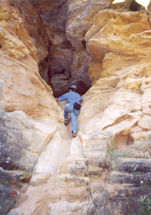 Exploring a cave in Buffalo Track Canyon